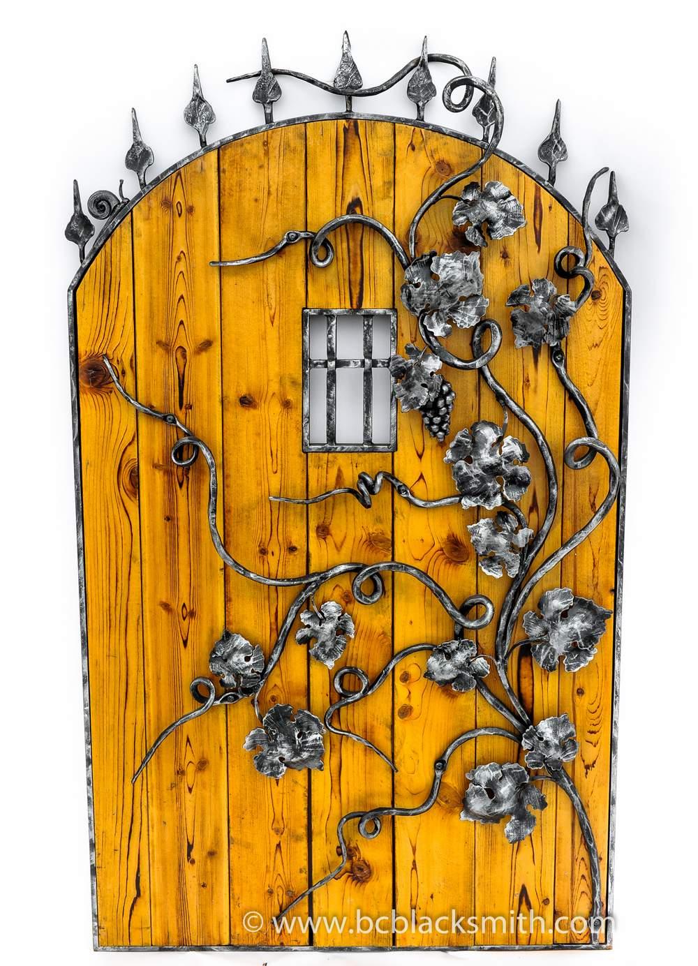 wrought iron and wood wine cellar door