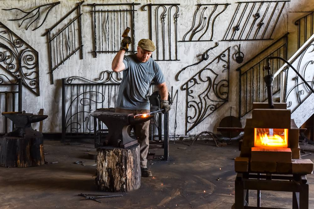 Blacksmith working at shop