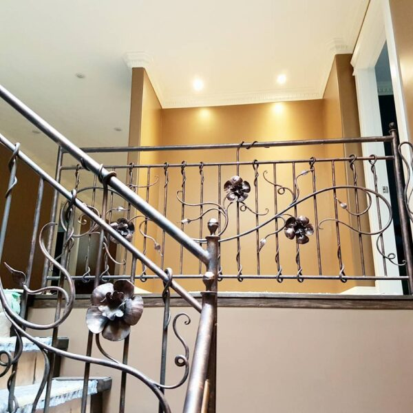 wrought iron railing with flowers